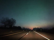 Foggy drive on the Pennsylvania turnpike watching the sunrise at the end of the road